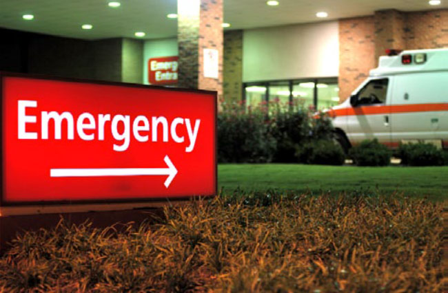 Photo courtesy of OSHA. Red sign with Emergency pointing to Hospital Emergency Room